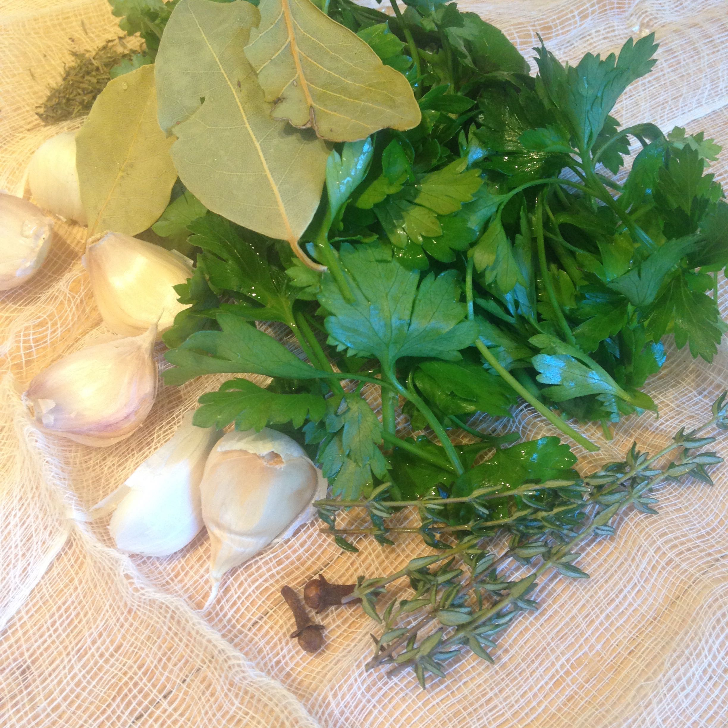 The bouquet garni for the beans is pretty important. Parsley, thyme, garlic and bay flavor the beans.