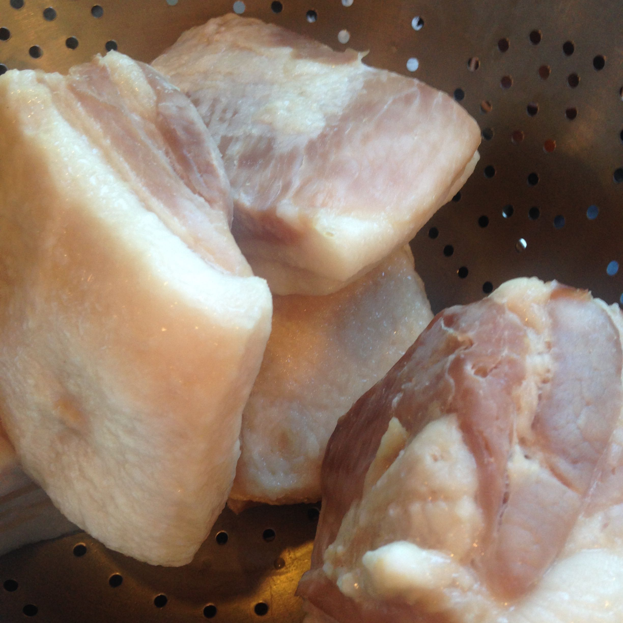 One inch chunks of salt pork are first boiled then drained before adding to the beans.